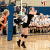 St. Charles East's Anne Hughes returns the ball during their 19-25, 22-25 Geneva Sectional semifinal loss to St. Charles North Tuesday.