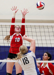 Sarah Nader- snader@shawmedia.com Marian Central's Rachel Giustino jumps to block the ball during Thursday's Class 3A Burlington Central Sectional semifinal against Burlington Central November 7, 2013. Marian Central defeated Central, 2-1.