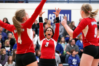 Sarah Nader- snader@shawmedia.com Marian Central's Frankie Taylor (center) celebrates a point during Thursday's Class 3A Burlington Central Sectional semifinal against Burlington Central November 7, 2013. Marian Central defeated Central, 2-1.
