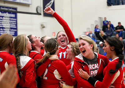 Sarah Nader- snader@shawmedia.com Marian Central celebrates after winning Thursday's Class 3A Burlington Central Sectional semifinal against Burlington Central November 7, 2013. Marian Central defeated Central, 2-1.