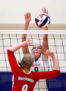 Sarah Nader- snader@shawmedia.com Burlington Central's Jenna Schudel jumps to block a ball during Thursday's Class 3A Burlington Central Sectional semifinal against Marian Central November 7, 2013. Marian Central defeated Central, 2-1.