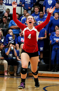 Sarah Nader- snader@shawmedia.com Marian Central's Katherine Adams celebrates a point Thursday's Class 3A Burlington Central Sectional semifinal against Burlington Central November 7, 2013. Marian Central defeated Central, 2-1.