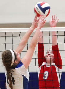 Sarah Nader- snader@shawmedia.com Marian Central's Alex Kaufmann jumps to block the ball during Thursday's Class 3A Burlington Central Sectional semifinal against Burlington Central November 7, 2013. Marian Central defeated Central, 2-1.