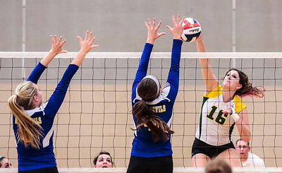 Kyle Grillot - kgrillot@shawmedia.com   Crystal Lake South senior Carly Nolan spikes the ball past Gurnee Warren juniors Lindsey Biedron (left) and Loren Fredricks during the final girls volleyball match of the Class 4A Belvidere North Sectional Thursday in Belvidere. Crystal Lake South won the match in two games.