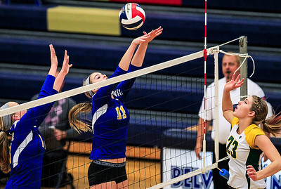 Kyle Grillot - kgrillot@shawmedia.com   Gurnee Warren sophomore Jenna Walczak (11) fights to block Crystal Lake South senior Sara Mickow's ball during the final girls volleyball match of the Class 4A Belvidere North Sectional Thursday in Belvidere. Crystal Lake South won the match in two games.