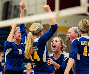 Kyle Grillot - kgrillot@shawmedia.com   The Gurnee Warren team celebrates a scored point during the second game of final girls volleyball match of the Class 4A Belvidere North Sectional Thursday in Belvidere. Crystal Lake South won the match in two games.