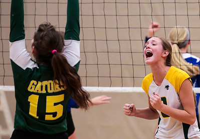 Kyle Grillot - kgrillot@shawmedia.com   Crystal Lake South senior Cassy Sivesind (right) celebrates with her team after a scored point during the second game of the final girls volleyball match of the Class 4A Belvidere North Sectional Thursday in Belvidere. Crystal Lake South won the match in two games.