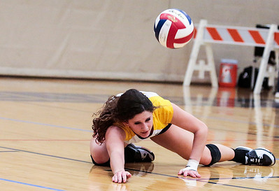 Kyle Grillot - kgrillot@shawmedia.com   Crystal Lake South senior Carly Nolan dives for a low ball during the second game of the final girls volleyball match of the Class 4A Belvidere North Sectional Thursday in Belvidere. Crystal Lake South won the match in two games.