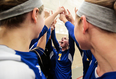 Kyle Grillot - kgrillot@shawmedia.com   Gurnee Warren senior Allyson Mitchell (7) cheers with her team before the start of the first game of the final girls volleyball match of the Class 4A Belvidere North Sectional Thursday in Belvidere. Crystal Lake South won the match in two games.