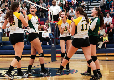 Kyle Grillot - kgrillot@shawmedia.com   The Crystal Lake South team celebrates a scored point during the first game of the final girls volleyball match of the Class 4A Belvidere North Sectional Thursday in Belvidere. Crystal Lake South won the match in two games.