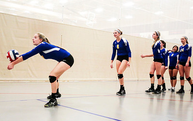 Kyle Grillot - kgrillot@shawmedia.com   The Gurnee Warren team warms up before the start of the first game of the final girls volleyball match of the Class 4A Belvidere North Sectional Thursday in Belvidere. Crystal Lake South won the match in two games.