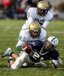 Sarah Nader- snader@shawmedia.com Cary-Grove's Zach McQuade fumbles the ball during the third quarter of Saturday's second-round Class 6A football playoff game against Boylan November 9, 2013. Cary-Grove was lost, 10-17.