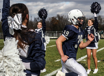 Sarah Nader- snader@shawmedia.com Cary-Grove's Tyler Pennington runs on the field before Saturday's second-round Class 6A football playoff game against Boylan November 9, 2013. Cary-Grove was lost, 10-17.