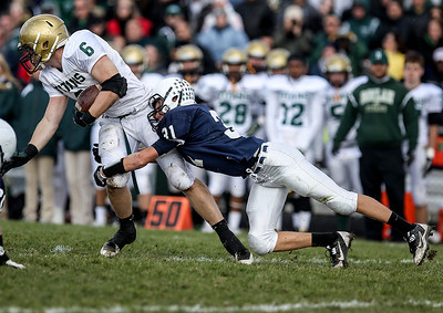 Sarah Nader- snader@shawmedia.com Boylan's Ian Riggs (left) is tackled by Cary-Grove's Travis Myerson during the second quarter Saturday's second-round Class 6A football playoff game in Cary November 9, 2013. Cary-Grove was lost, 10-17.