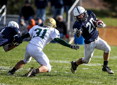 Sarah Nader- snader@shawmedia.com Cary-Grove's Matt Sutherland runs a play during the first quarter of Saturday's second-round Class 6A football playoff game against Boylan November 9, 2013. Cary-Grove was lost, 10-17.
