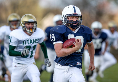 Sarah Nader- snader@shawmedia.com Cary-Grove's Tyler Pennington runs a play during the second quarter of Saturday's second-round Class 6A football playoff game against Boylan November 9, 2013. Cary-Grove was lost, 10-17.