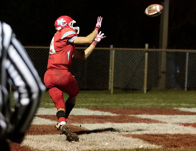 Kyle Grillot - kgrillot@shawmedia.com   Marian Central junior Jordan Niemeyer pulls in a catch for a touchdown in the fourth quarter of the Class 5A second round football game between Montini and Marian Central Friday in Woodstock. Montini won the game 40-7.