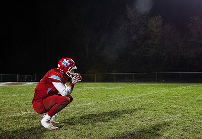 Kyle Grillot - kgrillot@shawmedia.com   Marian Central senior Brett Olsen takes a moment to himself after the end of the Class 5A second round football game between Montini and Marian Central Friday in Woodstock. Montini won the game 40-7.