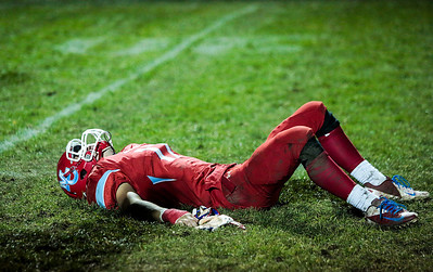 Kyle Grillot - kgrillot@shawmedia.com   Marian Central senior Brett Olsen lays on the ground after the final play of the Class 5A second round football game between Montini and Marian Central Friday in Woodstock. Montini won the game 40-7.
