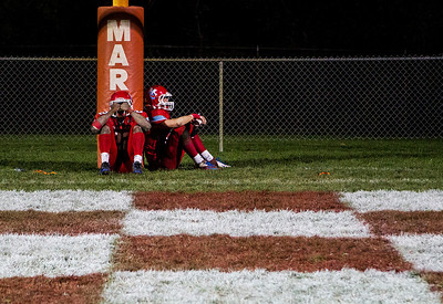 Kyle Grillot - kgrillot@shawmedia.com   Marian Central seniors Ephriam Lee and Brett Olsen take a final moment to themselves on the field after the end of  the Class 5A second round football game between Montini and Marian Central Friday in Woodstock. Montini won the game 40-7.