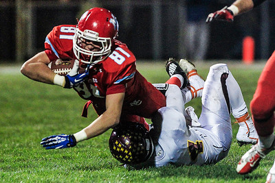 Kyle Grillot - kgrillot@shawmedia.com   Marian Central junior Matt Ricchiuto extends for a first during the second quarter of the Class 5A second round football game between Montini and Marian Central Friday in Woodstock. Montini won the game 40-7.