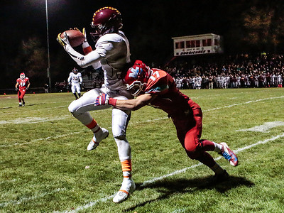 Kyle Grillot - kgrillot@shawmedia.com   Marian Central senior Brett Olsen tackles Montini junior Leon Thornton III out of bounds as he pulls in a catch  during the first quarter of the Class 5A second round football game between Montini and Marian Central Friday in Woodstock. Montini won the game 40-7.