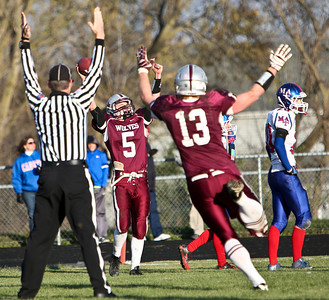 Josh Peckler - For the Northwest Herald  Prairie Ridge's Danny Meikel (5) celebrates with his hands in the air after catching the game winning catch against Marmion Academy during the IHSA Class 6A second round playoff game at Prairie Ridge High School Saturday, November 9, 2013.