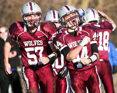 Josh Peckler - For the Northwest Herald  Prairie Ridge's Zack Greenberg (44) and Robbie Palmquist (57) celebrate a touchdown against Marmion Academy during fourth quarter the IHSA Class 6A second round playoff game at Prairie Ridge High School Saturday, November 9, 2013.