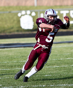Josh Peckler - For the Northwest Herald  Prairie Ridge's Danny Meikel (5) runs the ball against Marmion Academy during the IHSA Class 6A second round playoff game at Prairie Ridge High School Saturday, November 9, 2013.