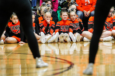 Kyle Grillot - kgrillot@shawmedia.com   Girls watch as the high school varsity pom team performs during the first Pom and Cheer Showcase at McHenry High School West Campus Sunday. All 11 of McHenry Junior Warriors Pom and Cheer teams take turns in the spotlight, raising funds for the nonprofit McHenry Junior Warriors Pom and Cheer organization.