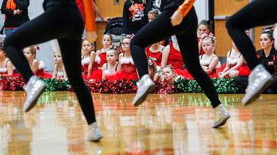 Kyle Grillot - kgrillot@shawmedia.com   Girls from the first and second grade bantam poms watch as the high school varsity pom team performs during the first Pom and Cheer Showcase at McHenry High School West Campus Sunday. All 11 of McHenry Junior Warriors Pom and Cheer teams take turns in the spotlight, raising funds for the nonprofit McHenry Junior Warriors Pom and Cheer organization.
