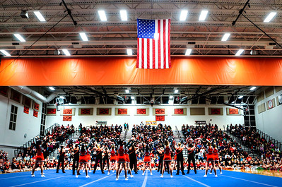 Kyle Grillot - kgrillot@shawmedia.com   The varsity cheer and pom teams perform during the first Pom and Cheer Showcase at McHenry High School West Campus Sunday. All 11 of McHenry Junior Warriors Pom and Cheer teams take turns in the spotlight, raising funds for the nonprofit McHenry Junior Warriors Pom and Cheer organization.