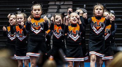 Kyle Grillot - kgrillot@shawmedia.com   The first and second grade bantam cheer team performs during the first Pom and Cheer Showcase at McHenry High School West Campus Sunday. All 11 of McHenry Junior Warriors Pom and Cheer teams take turns in the spotlight, raising funds for the nonprofit McHenry Junior Warriors Pom and Cheer organization.