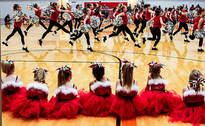 Kyle Grillot - kgrillot@shawmedia.com   Girls from the first and second grade bantam poms watch as the junior varsity pom team performs during the first Pom and Cheer Showcase at McHenry High School West Campus Sunday. All 11 of McHenry Junior Warriors Pom and Cheer teams take turns in the spotlight, raising funds for the nonprofit McHenry Junior Warriors Pom and Cheer organization.