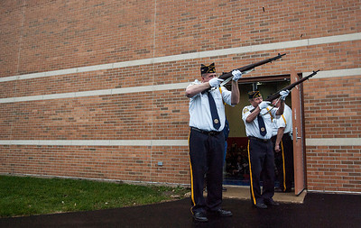 Kyle Grillot - kgrillot@shawmedia.com   American Legion Post 679 members Joe Uehlein (left) and Jim Beal fire off three rounds during the Veterans Day Service Monday at Parkview Elementary in Carpentersville. The service includes a parade of students, music, the posting of colors, a rifle salute, and playing of taps in observance of Veterans Day.