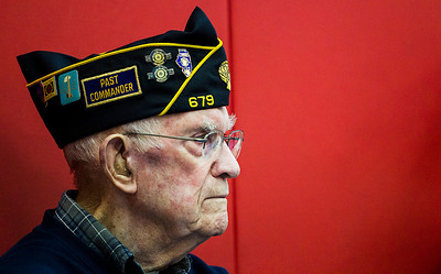 Kyle Grillot - kgrillot@shawmedia.com   U.S. Army veteran David Lueck of Carpentersville listens to the closing remarks of Chaplain Dexter Ball of the Carpentersville Fire Department during the Veterans Day Service Monday at Parkview Elementary in Carpentersville. The service includes a parade of students, music, the posting of colors, a rifle salute, and playing of taps in observance of Veterans Day.