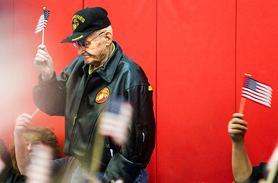 Kyle Grillot - kgrillot@shawmedia.com   U.S. Marine Corps veteran Robert Christensen of Carpentersville stands to be recognized with other marine corps veterans during the Veterans Day Service Monday at Parkview Elementary in Carpentersville. The service includes a parade of students, music, the posting of colors, a rifle salute, and playing of taps in observance of Veterans Day.