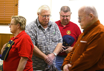 H. Rick Bamman -hbamman@shawmedia.com Veterans pray during the Huntley American Legion Post 673 Veterans Day ceremony on Monday, Nov. 11, 2013.