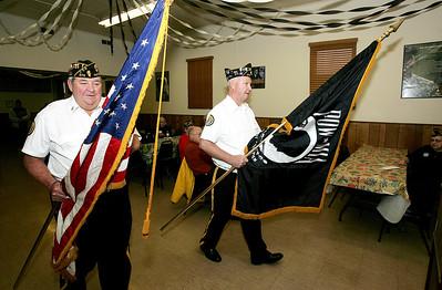 H. Rick Bamman - hbamman@shawmedia.com Post 673 Post vice commander Patrick Conley (left) and Commander Timothy Nash post the colors at the Huntley American Legion Post 673 at the start of the Veterans Day ceremony Monday, Nov. 11, 2013.