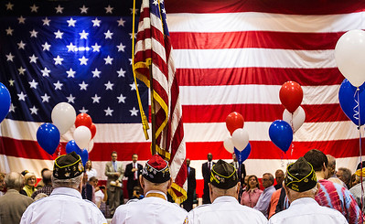 Kyle Grillot - kgrillot@shawmedia.com   The color guard advances towards the stage during the Veterans Day event at Crystal Lake South High School. Crystal Lake South invited more than 500 local veterans to be honored at their event, held in the gymnasium Monday November 11, 2013.