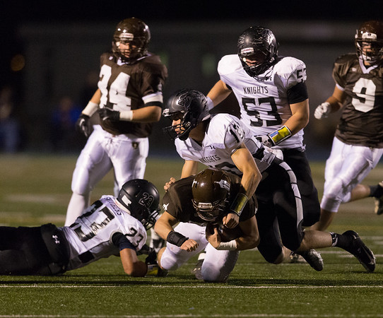Kaneland's Isaac Swithers (23) and Tyler Carlson (10) tackle Joliet Catholic's running back Michael Ivlow (30) at Joliet Memorial Stadium in Joliet, IL on Saturday, November 09, 2013 (Sean King for Shaw Media)