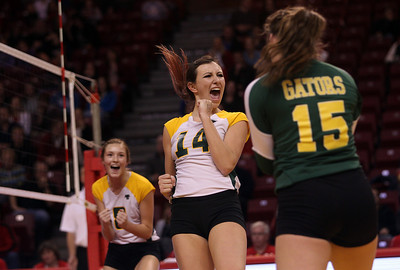 Sarah Nader - snader@shawmedia.com Crystal Lake South's Avalon Nero (center) celebrates a point during Friday's IHSA Class 4A semifinal against Benet at Illinois State University in Normal, IL November 15, 2013. Crystal Lake South lost, 0-2.