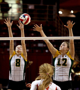 Sarah Nader - snader@shawmedia.com Crystal Lake South's Cassy Sivesind (left) and Nicole Slimko jump to block the ball during Friday's IHSA Class 4A semifinal against Benet at Illinois State University in Normal, IL November 15, 2013. Crystal Lake South lost, 0-2.