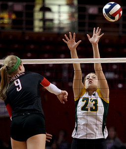 Sarah Nader - snader@shawmedia.com Crystal Lake South's Sara Mickow jumps to block the ball during Friday's IHSA Class 4A semifinal against Benet at Illinois State University in Normal, IL November 15, 2013. Crystal Lake South lost, 0-2.