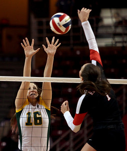 Sarah Nader - snader@shawmedia.com Crystal Lake South's Carly Nolan jumps to block the ball during Friday's IHSA Class 4A semifinal against Benet at Illinois State University in Normal, IL November 15, 2013. Crystal Lake South lost, 0-2.