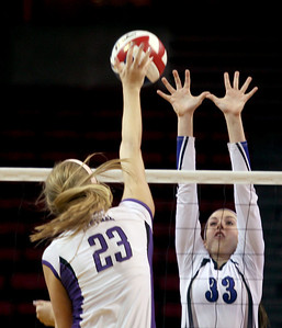 Sarah Nader - snader@shawmedia.com St. Francis' Laney Malloy jumps to block the ball hit from Central's Madison Timmermann during Friday's  IHSA Class 3A state semifinals at Illinois State University in Normal, IL Friday, November 15, 2013. St. Francis won, 2-0.