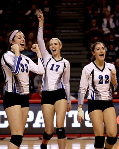 Sarah Nader - snader@shawmedia.com St. Francis' Laney Malloy (left), Mary Boken and Daniele Messa celebrate after winning Friday's  IHSA Class 3A state semifinals against Central at Illinois State University in Normal, IL Friday, November 15, 2013. St. Francis won, 2-0.