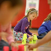 Fabyan Elementary School first-grader Bridget Feichter competes in a cup sport stacking race during her physical education class at the Geneva school Thursday afternoon.