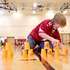 Fabyan Elementary School fifth-grader Caden Naselli competes in a cup sport stacking race during his physical education class at the Geneva school Thursday afternoon.