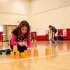 Fabyan Elementary School fifth-grader Brooke Evans competes in a cup sport stacking race during her physical education class at the Geneva school Thursday afternoon.